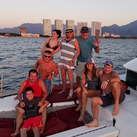 Photo of Don and Vinny on a boat overlooking Grand Venetian vacation rentals in Puerto Vallarta