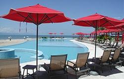 Iconic red umbrellas of the Grand Venetian vacation condominiums for rent in Puerto Vallarta