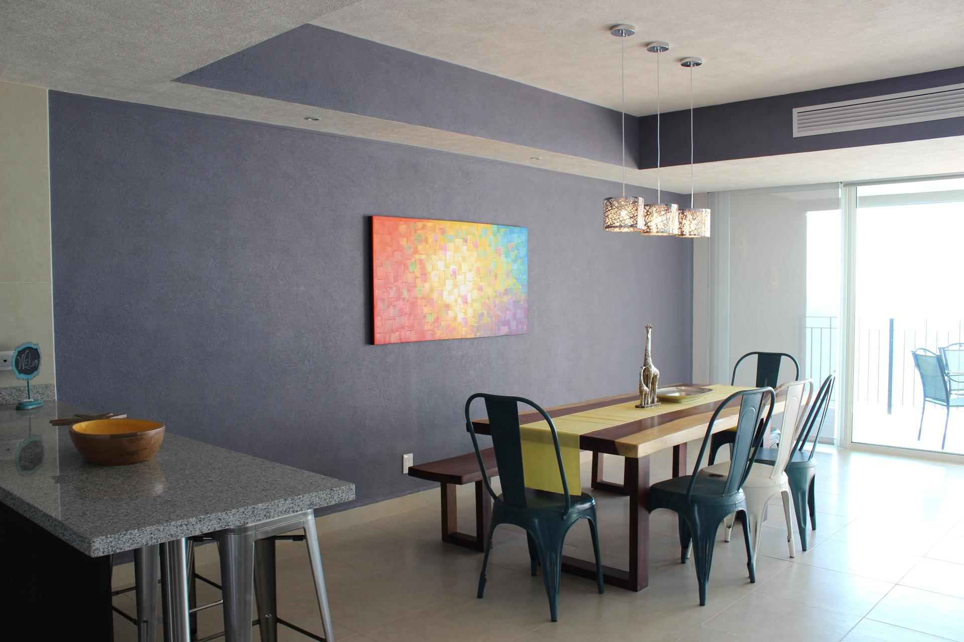 Modern dining table set of this 2 bedroom vacation rental condo in Grand Venetian Puerto Vallarta