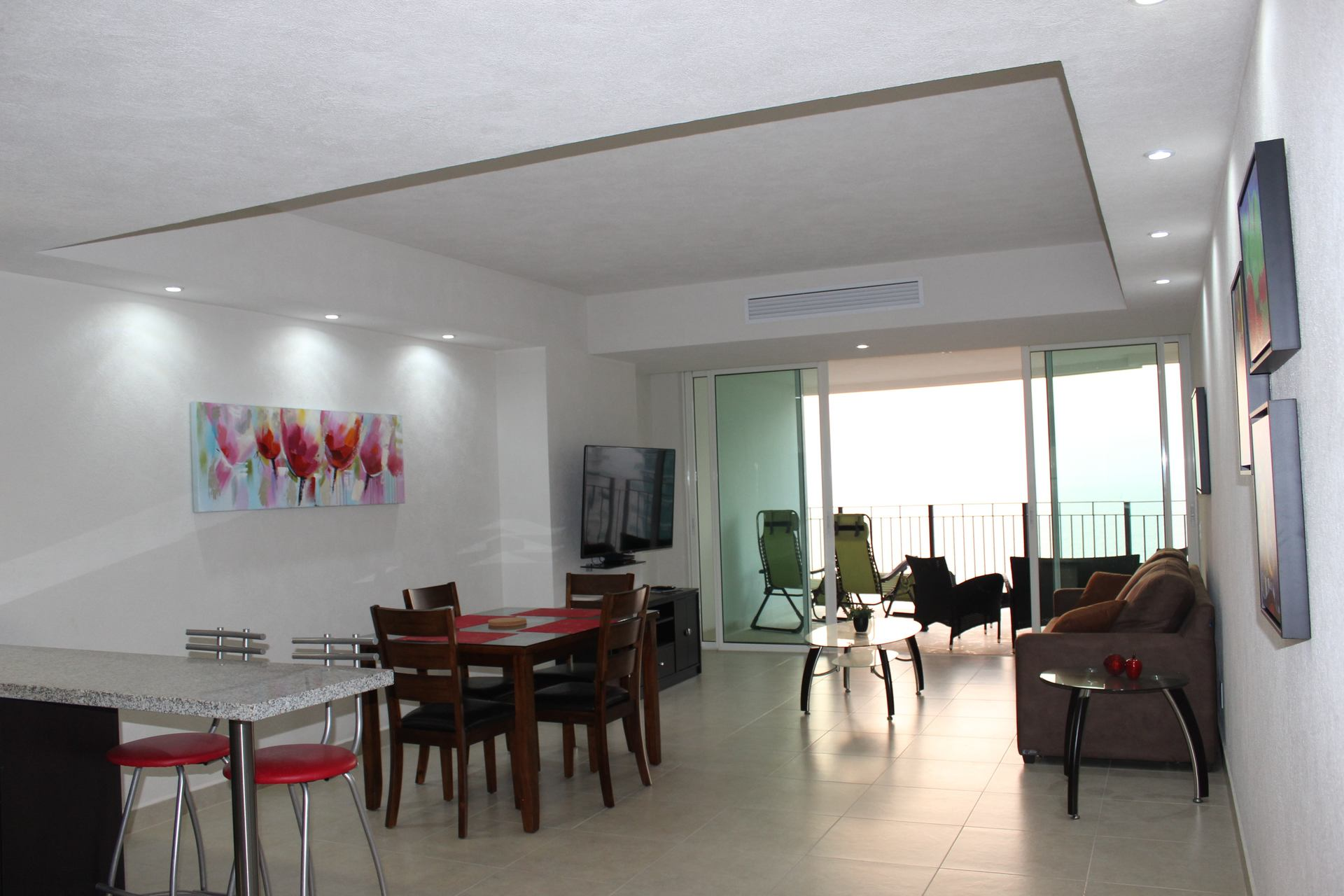 Classy decor of the living spaces in this 1 bedroom vacation condo rental in Grand Venetian Puerto Vallarta