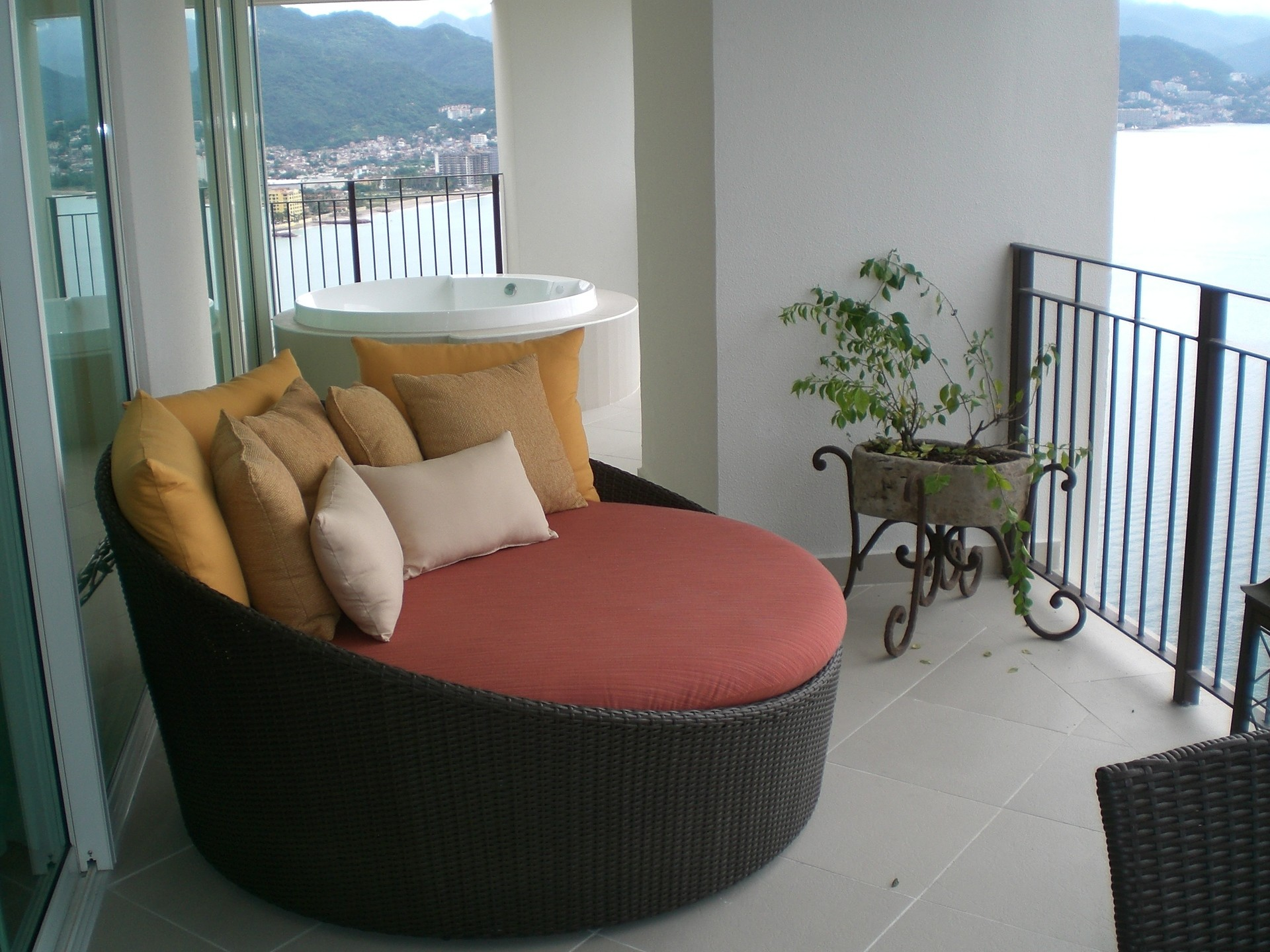 This Grand Venetian Vacation Condo for Rent has a stylish daybed on the patio to unwind by by the amazing view