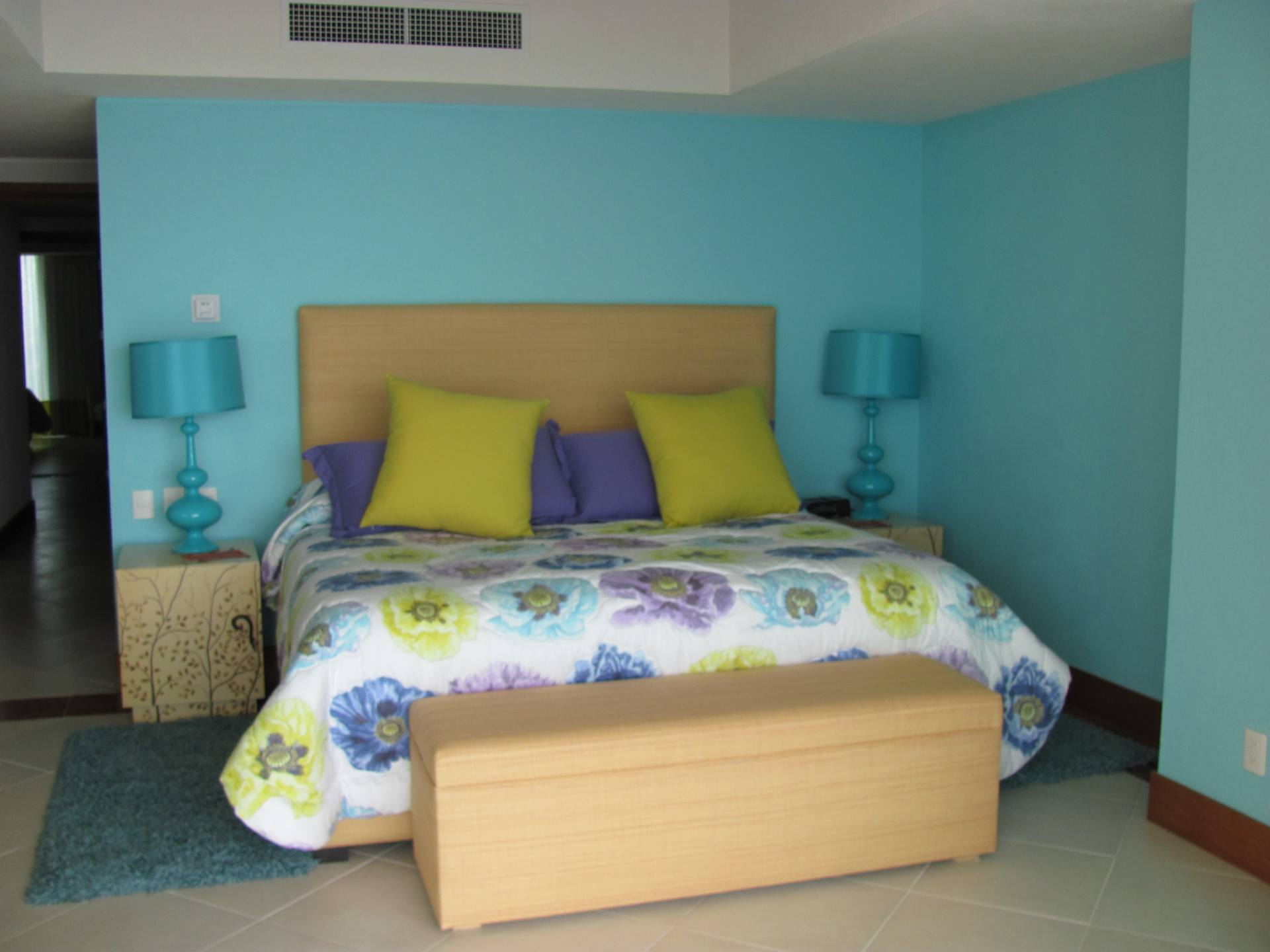 Bright color of master bedroom in this vacation rental condo in Grand Venetian Puerto Vallarta