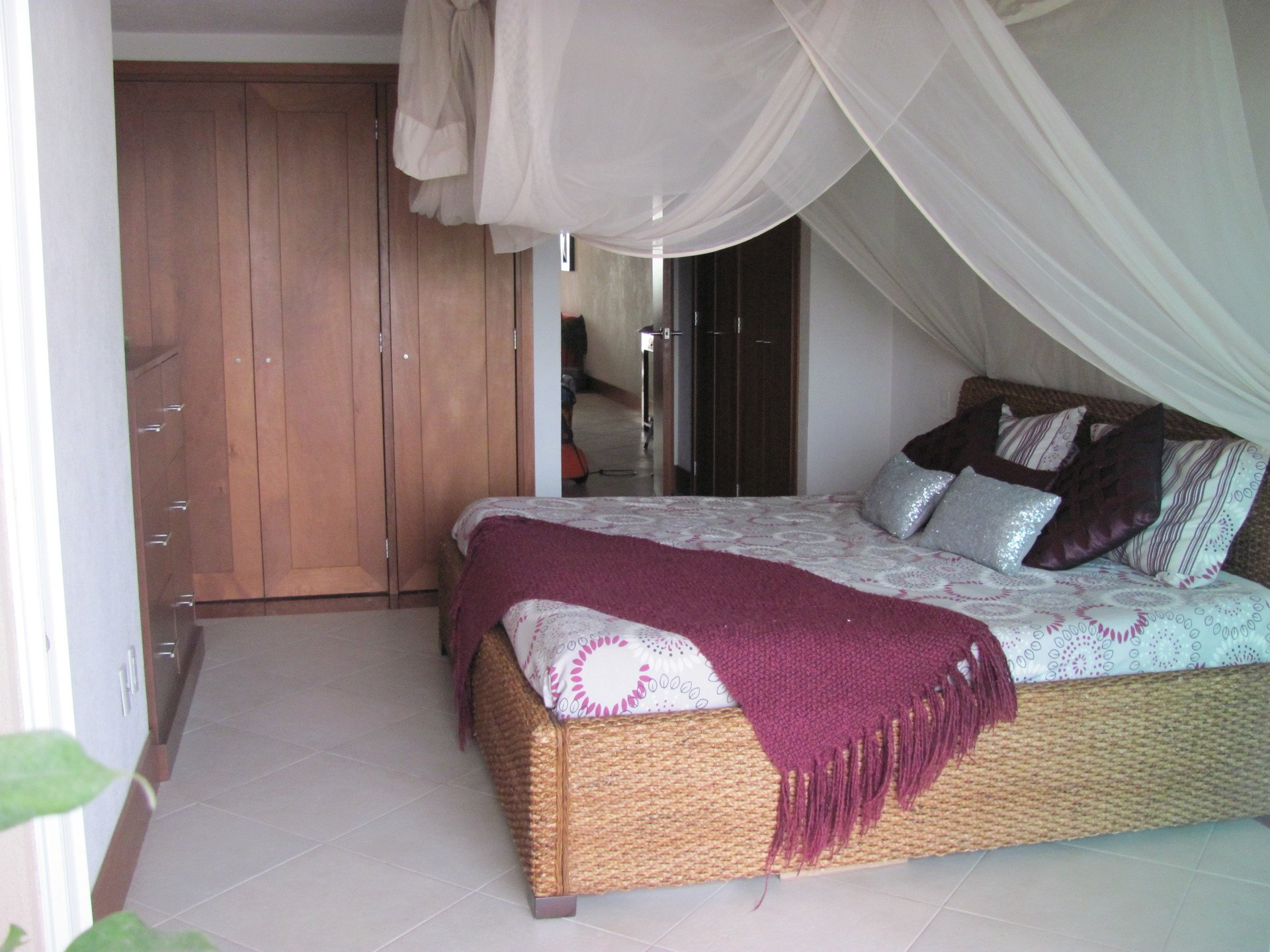 Stylish master bedroom of this 1 bedroom vacation rental condo at Grand Venetian Puerto Vallarta