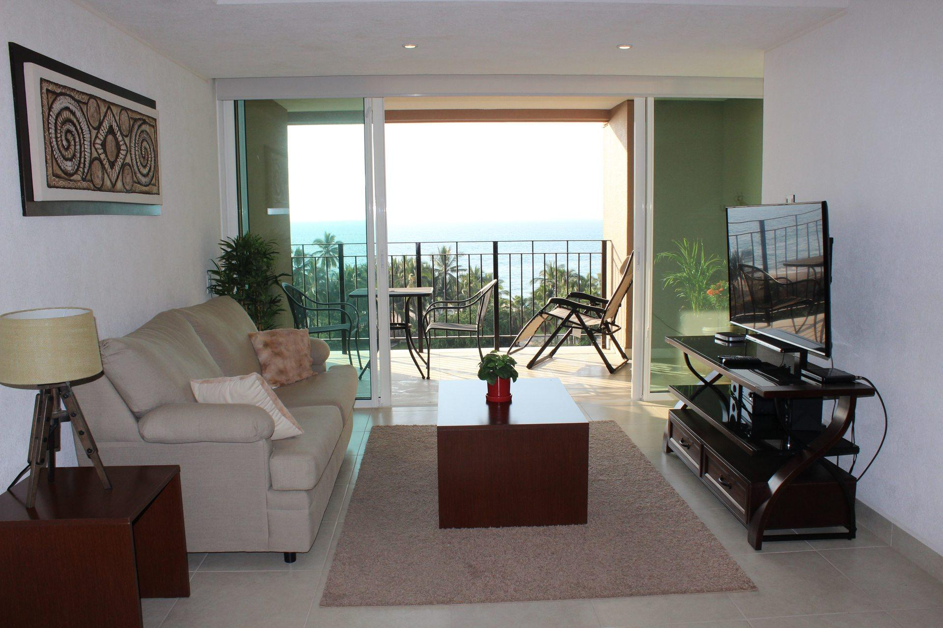 View of the deck and ocean horizon from this 1 bedroom vacation condo for rent in Grand Venetian Puerto Vallarta